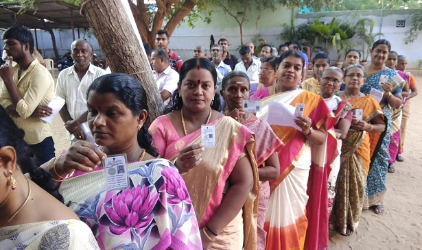 Voters line up outside polling booths in Tuticorin, Tamil Nadu