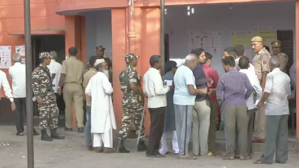 Voters begin to queue up outside polling booth number 256 in Kannauj