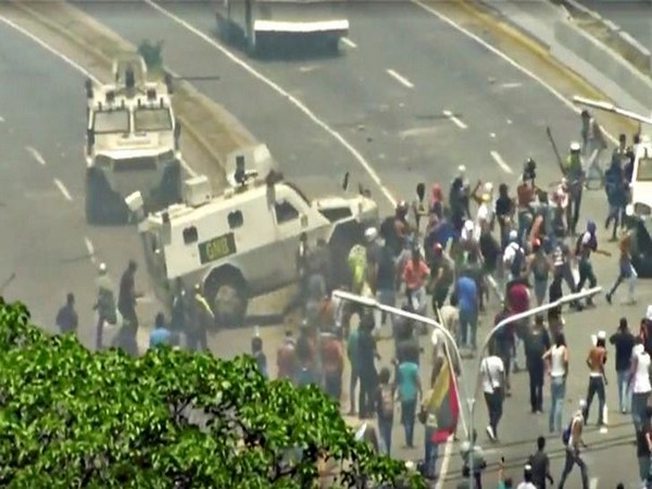 A Venezuelan National Guard (GNB) vehicle ploughs into opposition demonstrators in Caracas, Venezuela