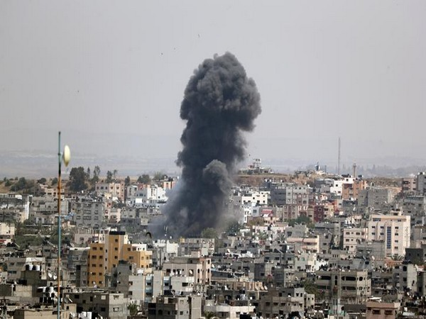 Smoke rises from a building in Gaza after Israeli airstrikes