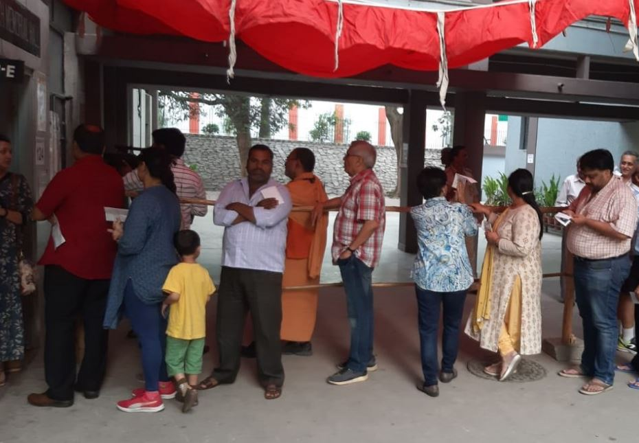 People standing in queue to cast vote