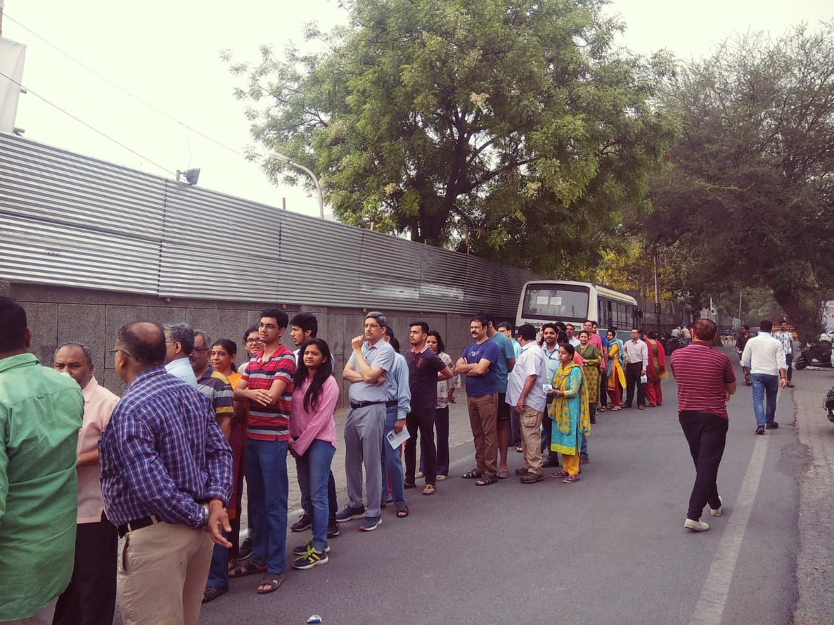 People standing in queue to cast vote in Delhi