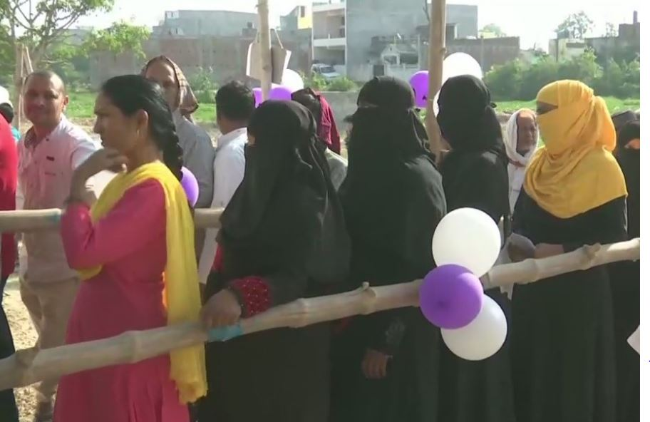 People standing in queue to cast vote
