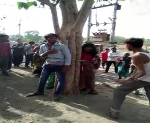 A man and his two relatives including a minor were tied to a tree and beaten up in Arjun Colony