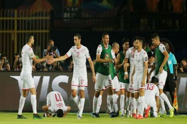 Tunisia players celebrating after scoring against Madagascar in the quarter-final match