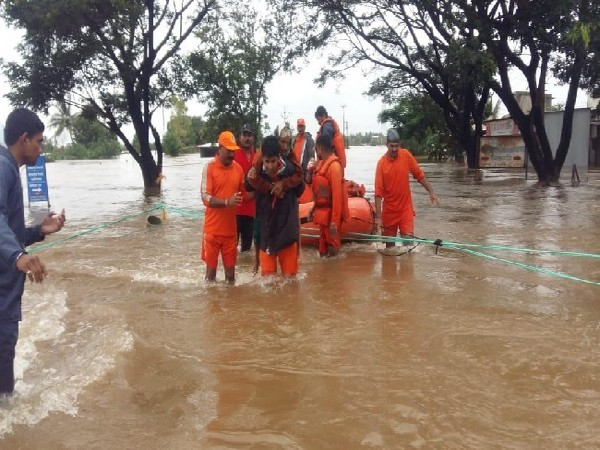 NDRF personnel rescuing people affected in floods in Maharashtra