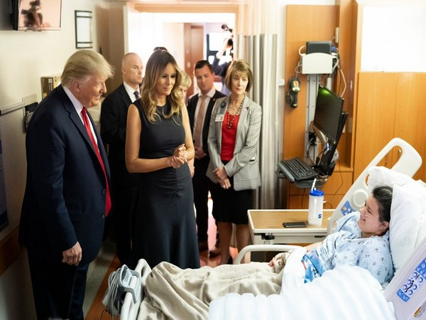 US President Donald Trump and First Lady Melania Trump meets a shooting victim at a hospital in Dayton