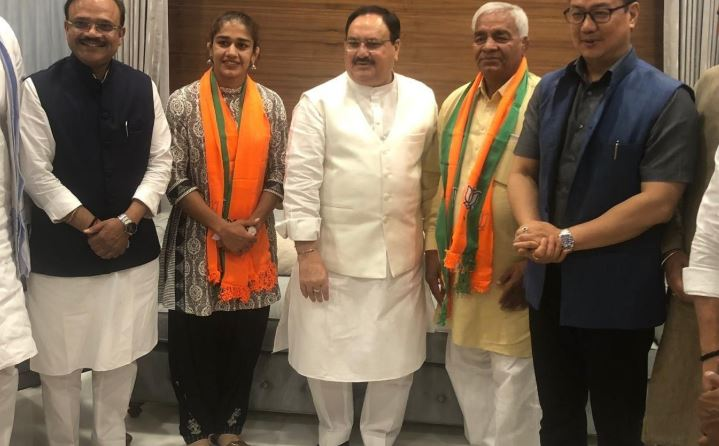 Wrestler Babita Phogat and her father Mahavir Singh Phogat meet BJP Working President JP Nadda