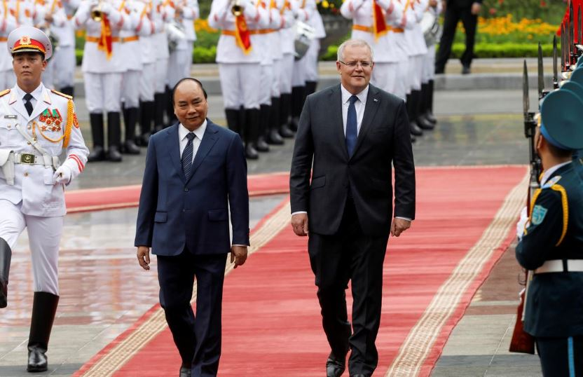 Australia's Prime Minister Scott Morrison reviews the guard of honour with his Vietnamese counterpart Nguyen Xuan Phuc