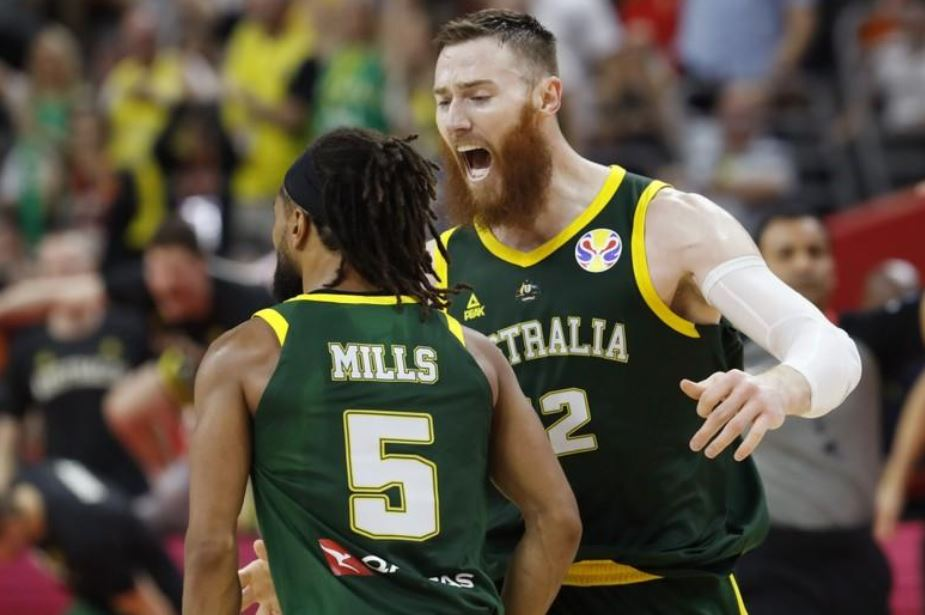 Australia's Patty Mills celebrates with Aron Baynes during the match