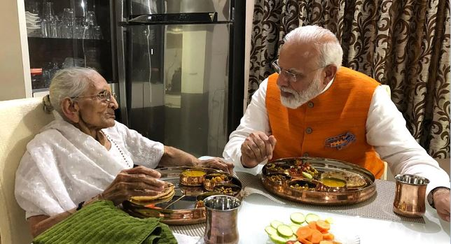 PM Modi having lunch with his mother at her residence in gandhinagar on Tuesday