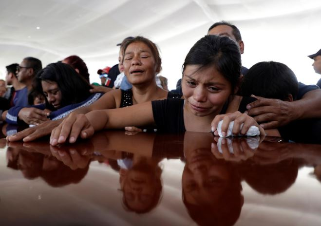 Relatives of a police officer, who was killed along other fellow police officers during an ambush by suspected cartel hitmen