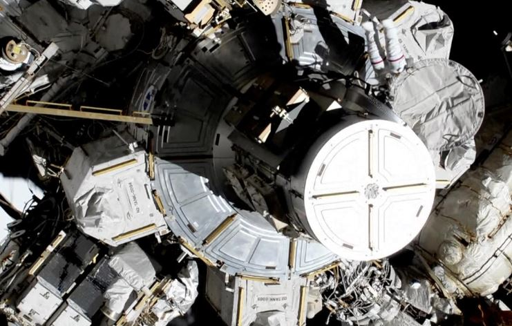 U.S. astronauts Christina Koch and Jessica Meir step out of the ISS to attempt the first all-female spacewalk, in this still image taken from NASA video