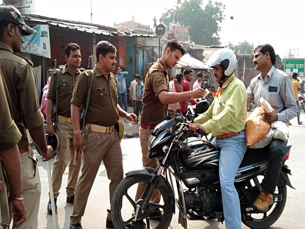 A policeman conducts checks as Section 144 imposed in Ayodhya