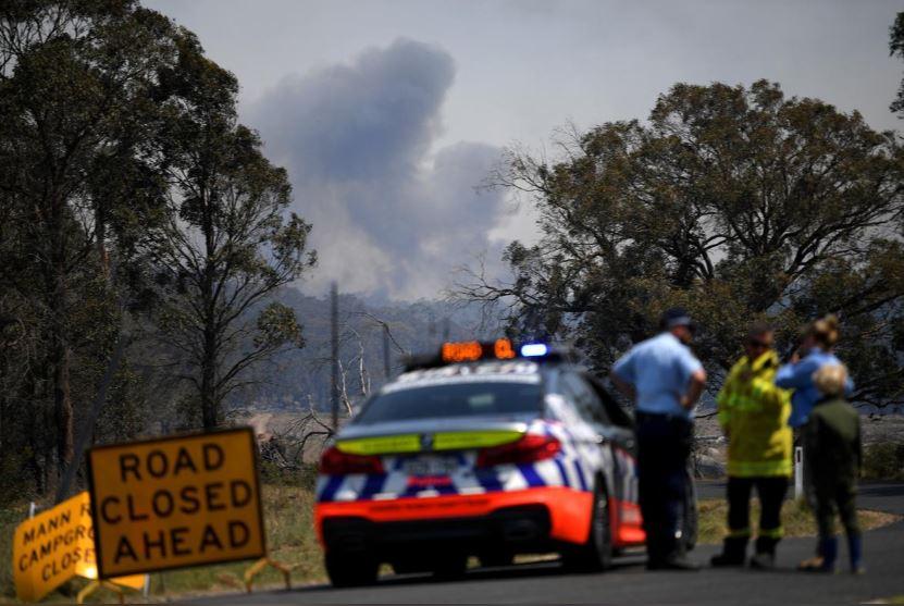 Smoke from a large bushfire is seen outside Wytaliba, near Glen Innes, Australia