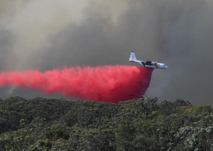 An air tanker drops fire retardant on the Gospers Mountain fire near Colo Heights, northwest of Sydney