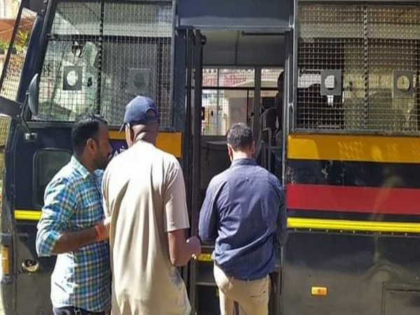 The arrested accused being taken by police in Mumbai