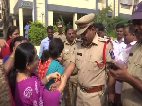 Women tied rakhis on police officer's hands in Telangana on Friday