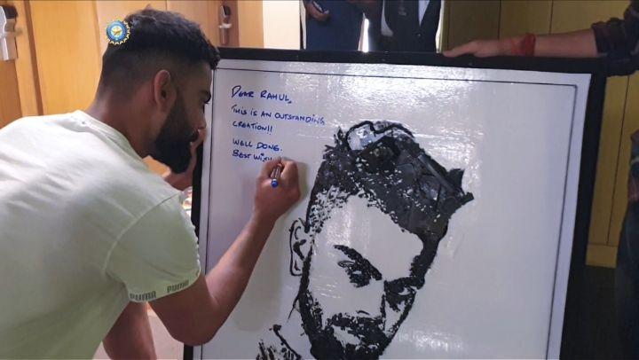 Virat Kohli with his portrait