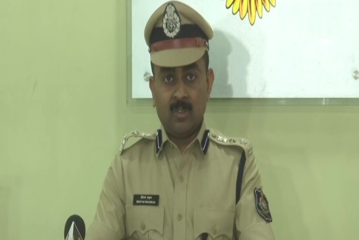 Deputy Commissioner of Police Crime Branch, Deepan Bhadran speaking at a press conference in Ahmedabad