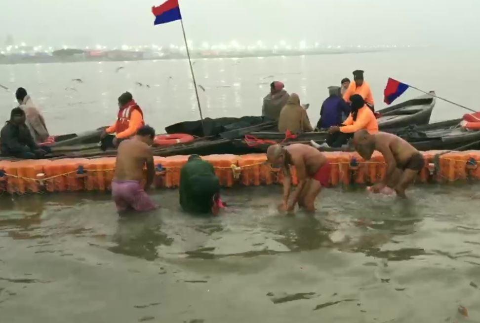 Devotees take holy dip