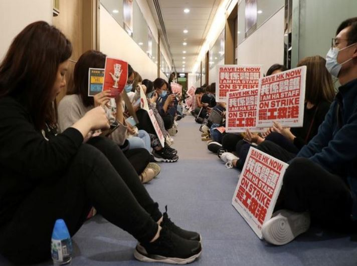 Medical workers wait at a corridor to demand an open dialogue on the novel coronavirus with the senior management, at the Hospital Authority's headquarters in Hong Kong