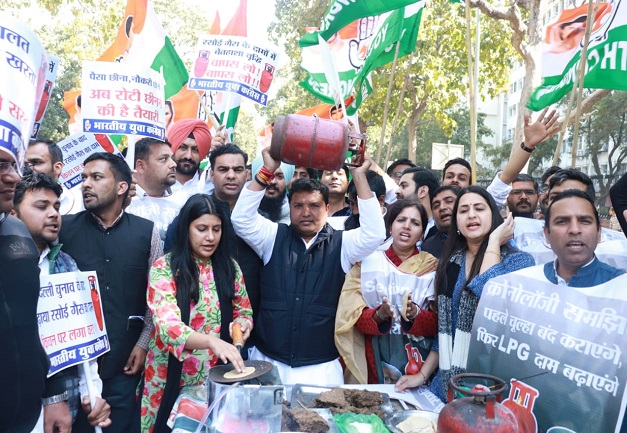 Members of the Indian Youth Congress protest against hiking price of LPG Cylinder
