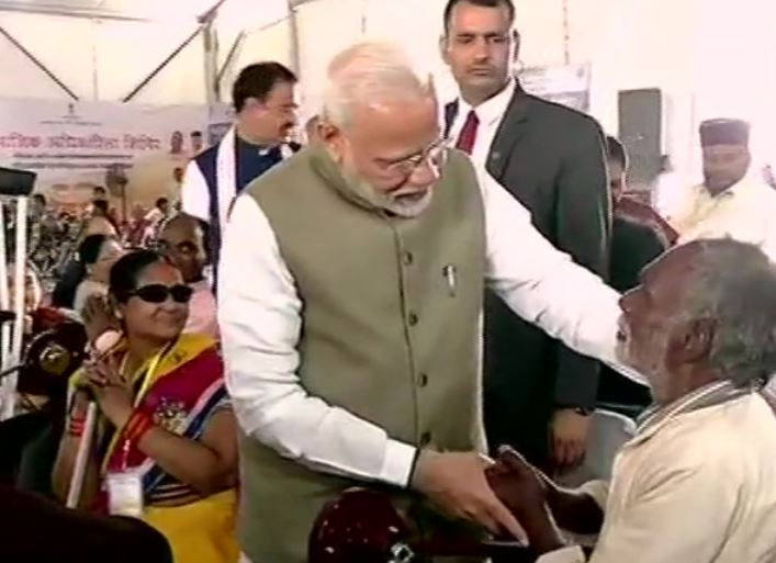 Prime Minister Narendra Modi at a distributive camp in Prayagraj on Saturday
