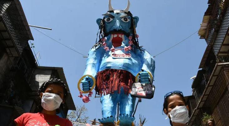 Holi celebration with a theme of coronavirus and women safety in Mumbai