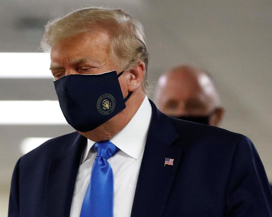 US President Trump wears mask in public for first time