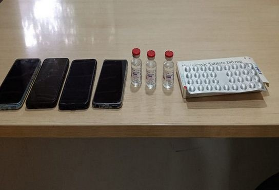 Seized COVID-19 antiviral drugs and mobiles
