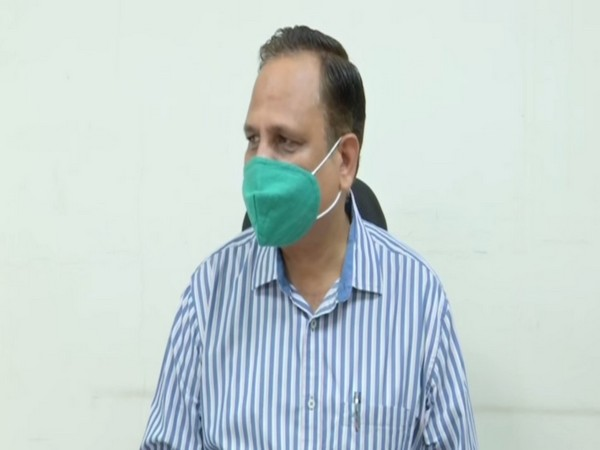 Delhi Health Minister Satyendar Jain speaking to reporters on Tuesday.