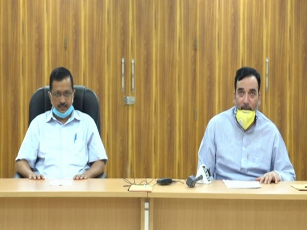 Delhi Chief Minister Arvind Kejriwal with Minister for Labour, Employment Gopal Rai at a press conference on Monday.