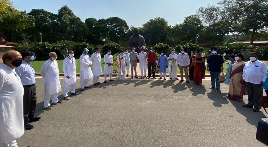 Opposition MPs stage protest before Gandhi statue in Parliament premises on Tuesday