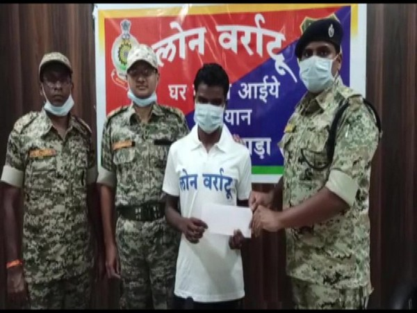 Kosa Markam surrenders before police under the 'Lone Varatu' (return to home) programme in Chhattisgarh's Dantewada on Monday