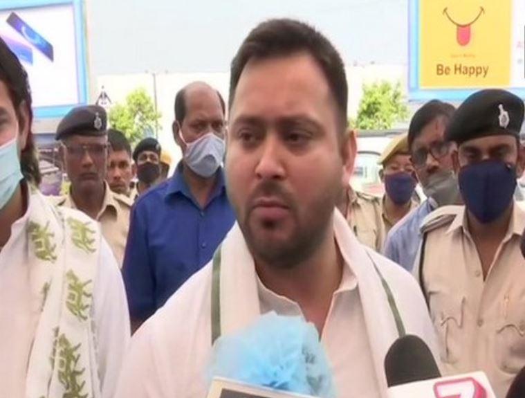 Rashtriya Janata Dal leader Tejashwi Yadav speaking to reporters on Friday