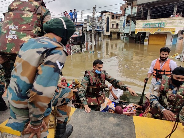 Indian Army flood relief teams carrying out rescue operations.
