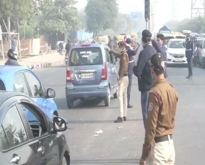 Traffic police manage vehicular movement near Chilla village in Delhi on Wednesday.