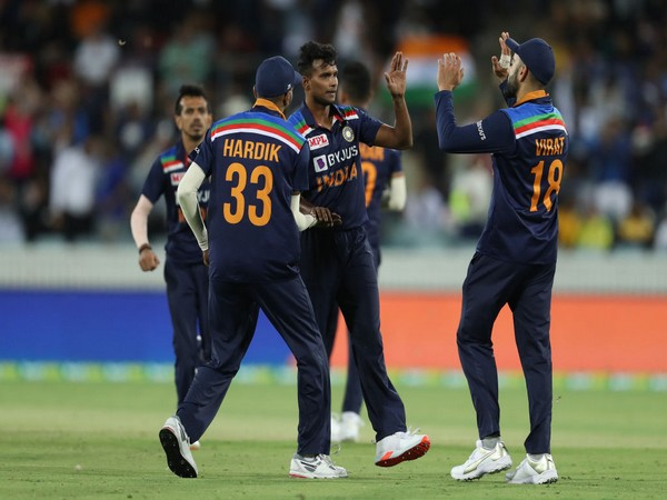 Indian players celebrating after taking a wicket