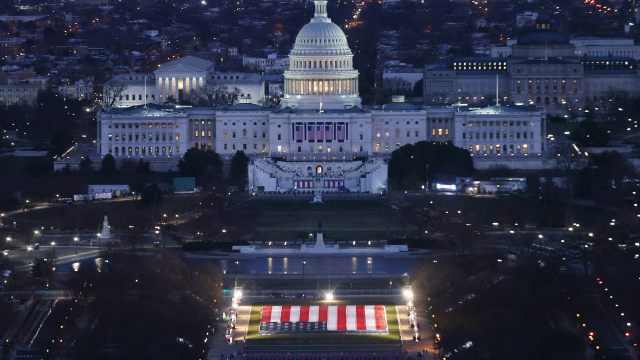"National Mall illuminated with pillars of light and ""Field of Flags"" for the Americans who can't attend the inauguration."
