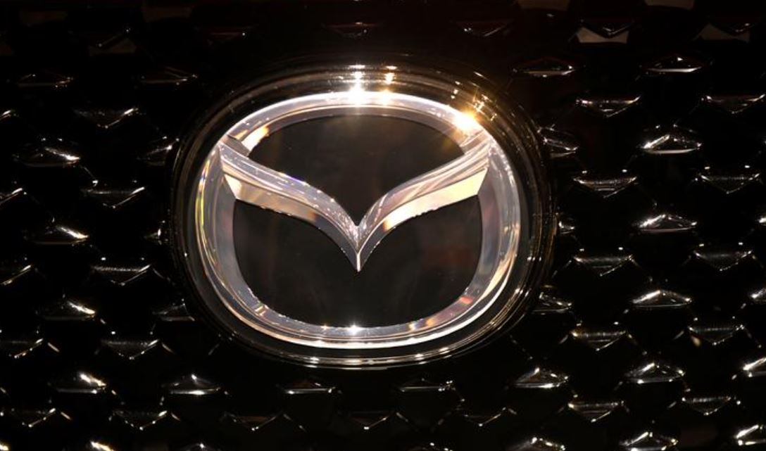 The logo of Mazda is pictured at the LA Auto Show in Los Angeles