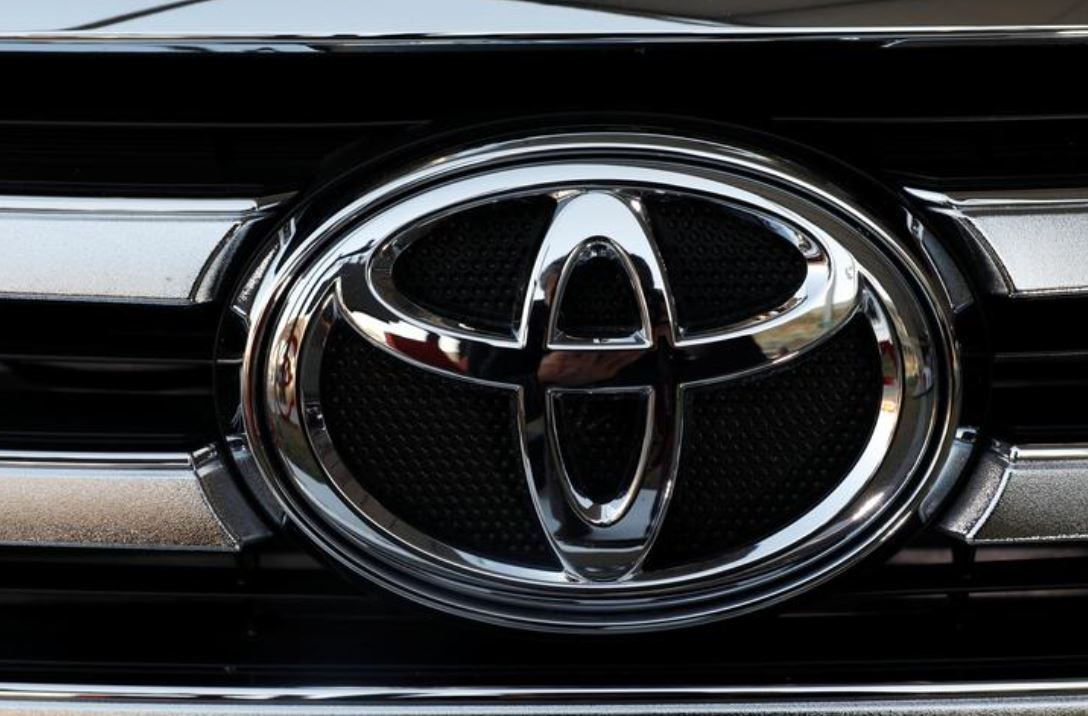 A Toyota Motor Corp. logo is seen on a car at the International Auto Show