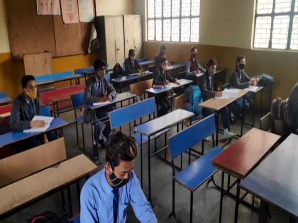Students attend classes at a Moradabad school after schools in Uttar Pradesh reopened for classes 6 to 8 on Wednesday.