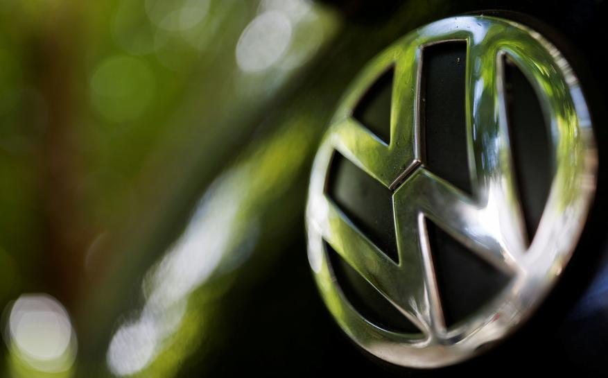 A logo of German carmaker Volkswagen is seen on a car parked