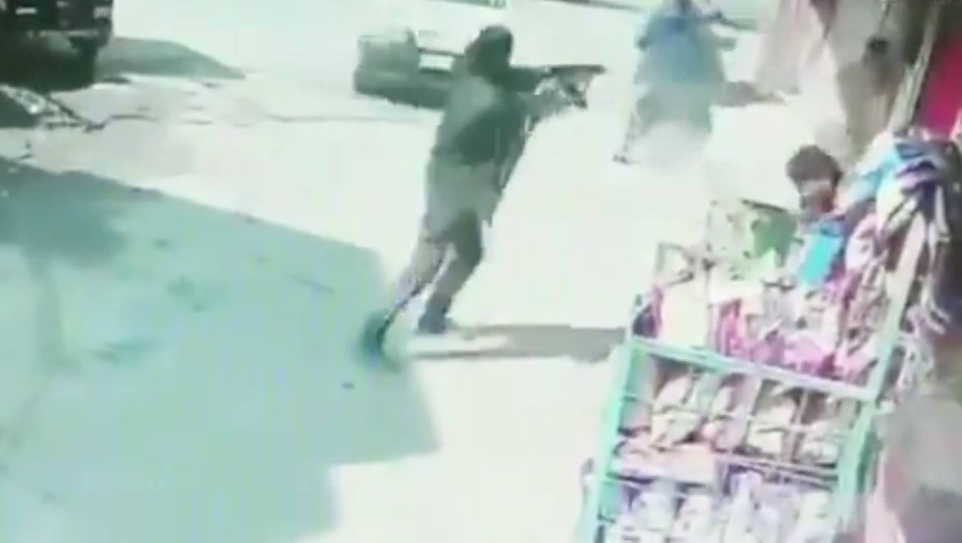 Terrorist opens fire in Baghat Barzulla of Srinagar district in Kashmir (A still from a CCTV Footage)