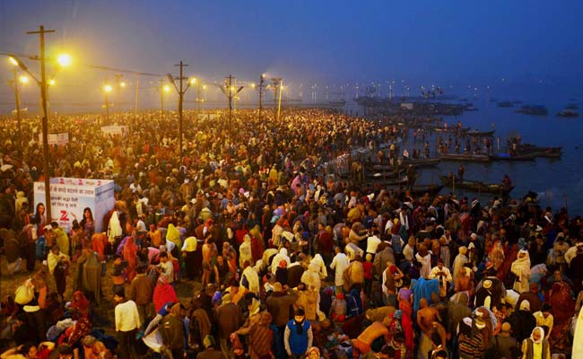 Devotees Take Holy Dip During Magh Mela