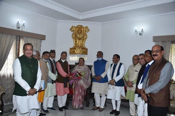 BJP leader Tirath Singh Rawat meets Governor Baby Rani Maurya