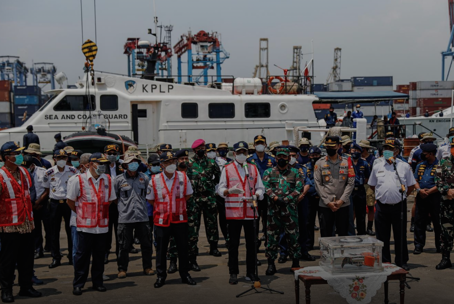 National Transportation Safety Committee (KNKT) officials place the Cockpit Voice Recorder (CVR) of Sriwijaya Air flight SJ 182 on a table at Tanjung Priok Port in Jakarta,