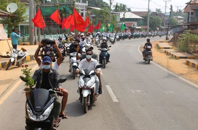 People take part in a motorcycle parade during a protest against the military coup, in Launglon township, Myanmar