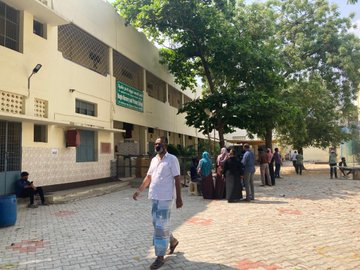People Standing in queue to cast their vote